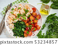 Grilled shrimps and tomatoes with spinach, garlic  53234857