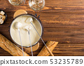 Cheese fondue with bread wine and grape 53235789