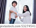 Young Asian mom dressed up son outfits for 53274541