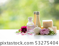 Floral spa treatments on white wooden table. 53275404