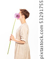 lilac flower hands woman dress white 53291755