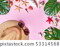 Beach accessories: sea shell, starfish, tropical palm leaves, straw hat and sun glasses on pink 53314568