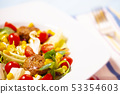 Colorful fresh vegetable salad with meatballs and corn seeds 53354603