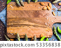 Wooden chopping board with asparagus, nuts frame 53356838