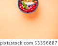 Yogurt bowl with raspberries and granola 53356887