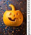 Halloween carved squash and confetti. Dark 53356933