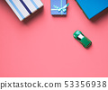 Gift boxes and toy car on pink background 53356938