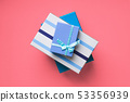 Gift boxes stack on pink coral background 53356939