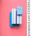 Gift boxes stack on pink coral background 53356941