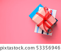 Gift boxes stack on pink coral background 53356946