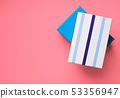 Gift boxes stack on pink background 53356947