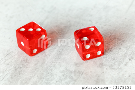 Two translucent red craps dices on white board showing Fever Five Little Phoebe number 3 and 2  53378153