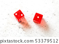 Two red craps dices showing Ace Deuce number 2 and 1 overhead shot on white board 53379512