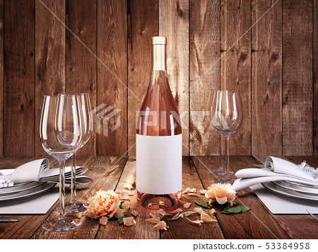 Dinner for two with a bottle of rose wine. 53384958