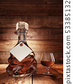 Cognac on a wooden table. 53385132