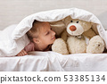 little child girl playing with teddy bear 53385134