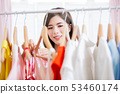 woman choosing clothes at home 53460174