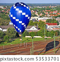 Hot air balloon over the city 53533701