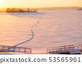 winter sunset over field 53565961