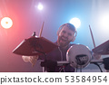 People, hobbies and music concept - close up portrait of a man with headphones playing electronic 53584954
