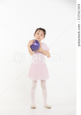 Asian girl in pink dress is holding ball.. 53592369
