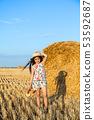 Adorable girl in rye field on sunset with a basket 53592687