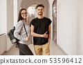 Couple of happy students in university. 53596412