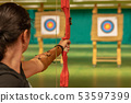 archery in the sports hall. Competition for the best shot an arrow into targets 53597399