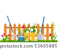 Garden cart with flower pots near the fence. 53605885