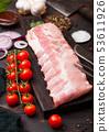 Fresh raw pork ribs on chopping board  53611926