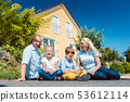 Family in front of their home 53612114