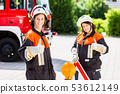 Female fire fighters setting up attention sign 53612149