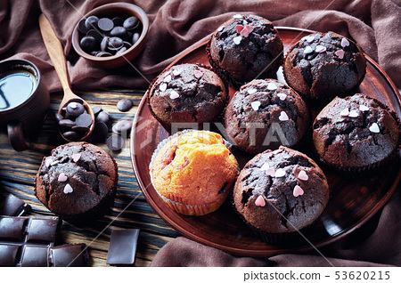 freshly baked sweet chocolate muffins, top view 53620215