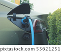 Electric car at a charging station 53621251