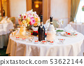 Table set for wedding banquet with candles,flowers 53622144