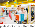 Mother with her girl have a purchase in kids store 53623362