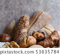 Different types of baking still life. Buns croissants, muffins and loaves, bread patties on textile 53635784