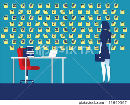 Businesswoman with wall full of reminder notes. 53640367