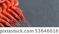 Raw shrimps over dark background 53646016