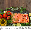 Salmon with vegetables, olive oil and herbs 53646089