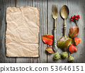 Vintage fork and knife with autumn leaves on wood 53646151