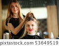 Girl Client Getting Hairstyle by Hairdresser 53649519