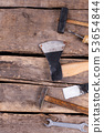 Various working tools on wooden boards background. 53654844