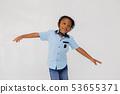 African American preschool boy wearing hard hat helmet outstretching arms 53655371