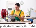 Man repairman repairing vacuum cleaner  53666564