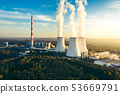 A Power plant with white smoke over it's chimneys 53669791