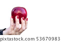 female hand holding a red apple closeup 53670983