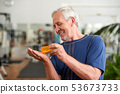Man pouring a pill from into hand. 53673733