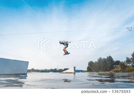 Wake boarding sportsman portrait, sport and active lifestyle, man photo portrait 53678893