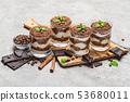 Classic tiramisu dessert in a glass on dark concrete background 53680011